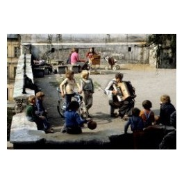 Musician surrounded by children, 1970